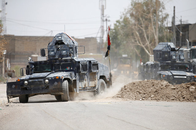 Military vehicles of Iraqi security forces are seen in Falluja, Iraq, June 25, 2016. (Photo by Thaier Al-Sudani/Reuters)