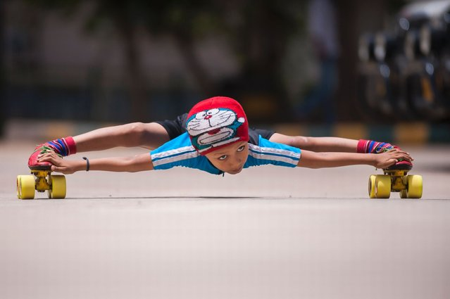 Gagan Satish practices limbo-skating at a local sports complex in Bengaluru, India. (Photo by Arkaprava Ghosh/Barcroft Media India)