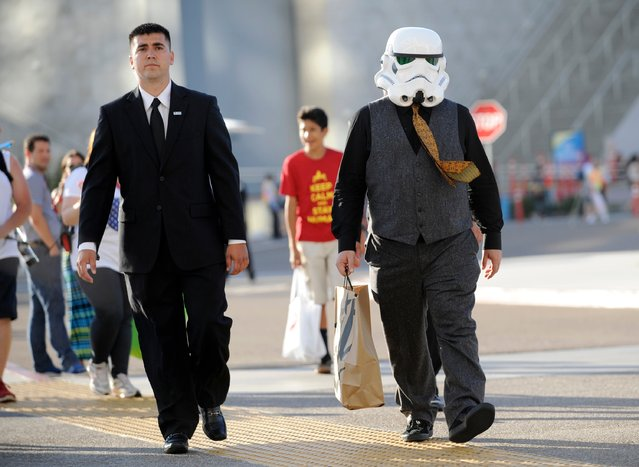 Actor Jack Black, wearing a Star Wars Stormtrooper mask, right, walks outside the convention center on Day 1 of Comic-Con International on Thursday, July 24, 2014, in San Diego. (Photo by Chris Pizzello/Invision/AP Photo)