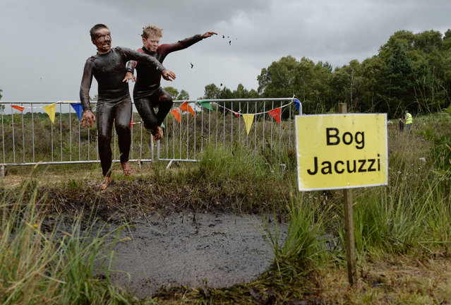 Patrick Colan-O'Leary (L) and Conor McCarthy (R) take a dip in the Bog Jacuzzi after takes part in the Irish Bog Snorkelling championship this afternoon at Peatlands Park on July 27, 2014 in Dungannon, Northern Ireland. The annual event sees male and female competitors swim the 60m length of the bog watched by scores of spectators and takes place on International Bog Day. (Photo by Charles McQuillan/Getty Images)