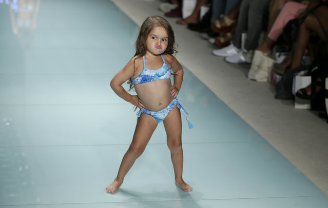 Model Taylen Biggs, 3, walks down the runway wearing Lybethras swimwear at a FUNKSHION fashion show during Swim Week, Sunday, July 23, 2017, in Miami Beach, Fla. (Photo by Lynne Sladky/AP Photo)