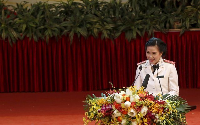 Police lieutenant Truong Thi Thu Hien from Ha Tinh province speaks during celebrations to commemorate the 70th anniversary of the establishment of the Vietnam Public Security police force at the National Convention Center in Hanoi August 18, 2015. (Photo by Reuters/Kham)