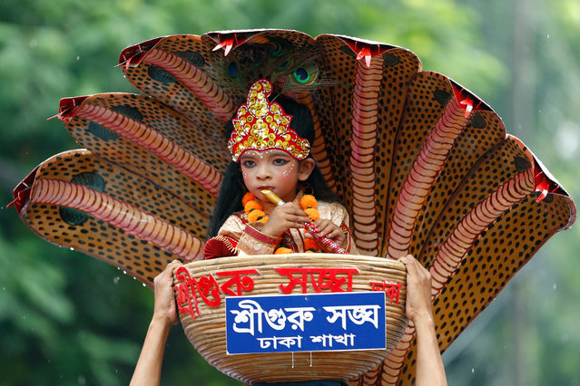 A boy dressed as Lord Krishna is pictured while Hindu devotees march on the streets to celebrate Janmashtami festival, which marks the birth anniversary of Lord Krishna, in Dhaka, August 14, 2017. (Photo by Mohammad Ponir Hossain/Reuters)