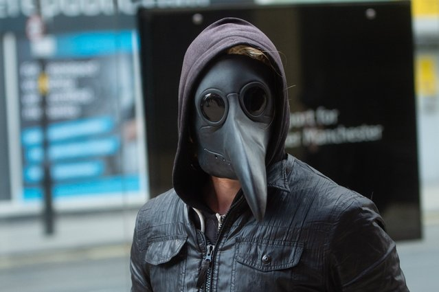 Shoppers and commuters in Manchester wearing face masks on February 28, 2020, including plague doctor masks due to the Coronavirus crisis in the UK. (Photo by Mario Forshow/Cavendish Press)