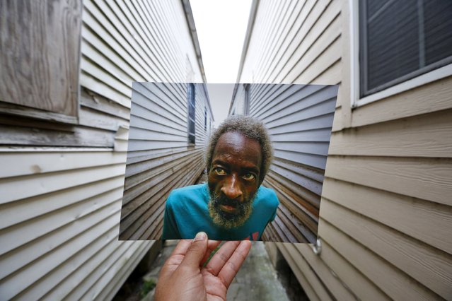 Photographer Carlos Barria holds a print of a photograph he took in 2005, as he matches it up at the same location 10 years on, in New Orleans, United States, August 16, 2015. The print shows Joshua Creek looking at the height that the floodwaters from Hurricane Katrina reached at his house, September 13, 2005. (Photo by Carlos Barria/Reuters)