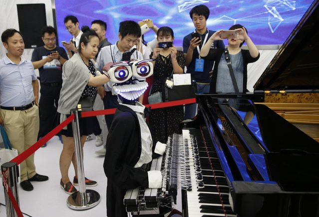 Robot pianist Teo Tronico performs at the World Robot Conference (WRC) 2017 at Etrong International Exhibition & Convention Center on August 22, 2017 in Beijing, China. The World Robot Conference 2017 is held from August 23 to 27 in Beijing. (Photo by Liu Guanguan/China News Service/VCG via Getty Images)