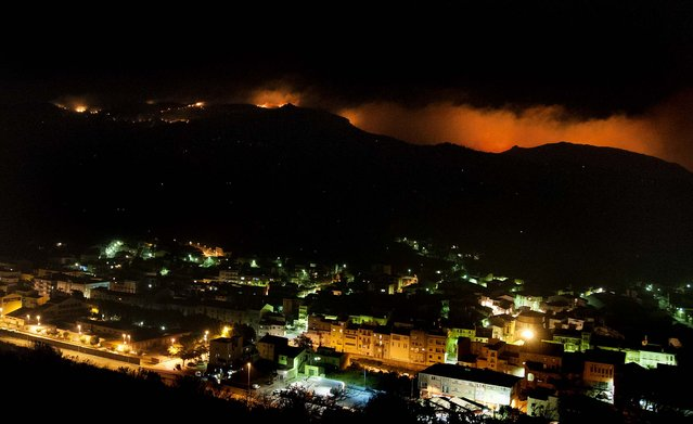 A forest burns on the mountains in La Jonquera, Spain, near the border with France on July 22, 2012. Regional officials say wildfires have burned almost 17.297 acres of forest so far. (Photo by Josep Ribas/Associated Press)