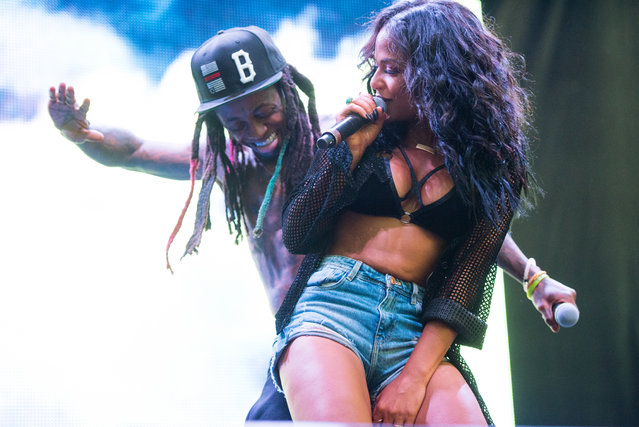 (L-R) Lil Wayne and Christina Milian perform onstage during the 2015 Billboard Hot 100 Music Festival at Nikon at Jones Beach Theater on August 22, 2015 in Wantagh, New York. (Photo by Noam Galai/WireImage)