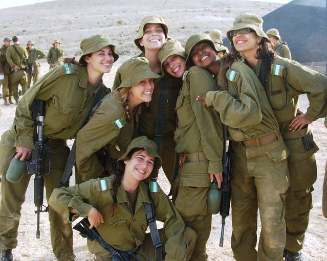 """Female Soldiers Take a Break in the Desert Sun"", May 16, 2011. A diverse group of female infantry instructors take a break from their intensive course in southern Israel. After completing the infantry instructors course, the female instructors are responsible for training combat soldiers on battlefield tactics including various weaponry and combat armored vehicles."