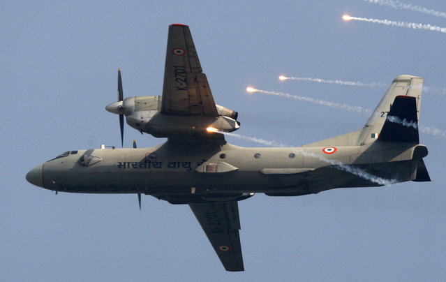 In this Thursday, October 8, 2009, file photo, an Indian Air Force's (IAF) AN-32 transport aircraft releases chaff as it flies past the IAF Day Parade in New Delhi, India. A spokesman for India's defense ministry says the Indian air force has lost contact with a transport plane AN-32 with 29 people on board. A massive search by the air force, navy and coast guard has been launched. (Photo by Mustafa Quraishi/AP Photo)