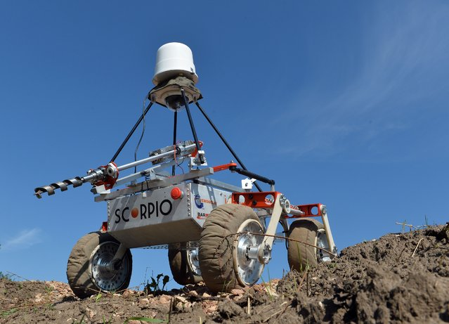 "The ""Scorpio"" Mars rover constructed by students of the Polish Wroclaw University is pictured before the European Rover Challenge 2014 on September 4, 2014 in Checiny, Poland. (Photo by Janek Skarzynski/AFP Photo)"