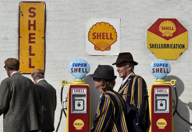 Visitors and car enthusiasts walk past vintage petrol pumps at the Goodwood Revival historic motor racing festival in Goodwood, near Chichester in south England, Britain, September 11, 2015. (Photo by Toby Melville/Reuters)