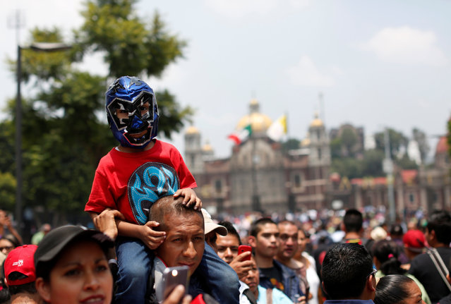 A child wearing a Mexican wrestler's mask takes part in an annual pilgrimage to the Basilica of Our Lady Guadalupe in Mexico City, Mexico August 25, 2016. (Photo by Carlos Jasso/Reuters)