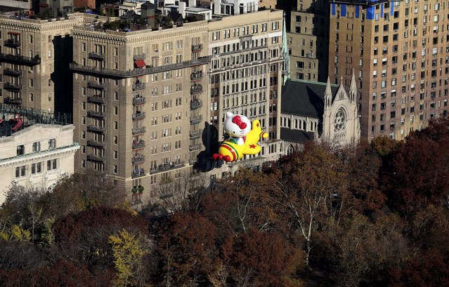The Hello Kitty balloon floats during the 86th annual Macy's Thanksgiving Day Parade in New York. (Photo by Librado Romero/The New York Times)
