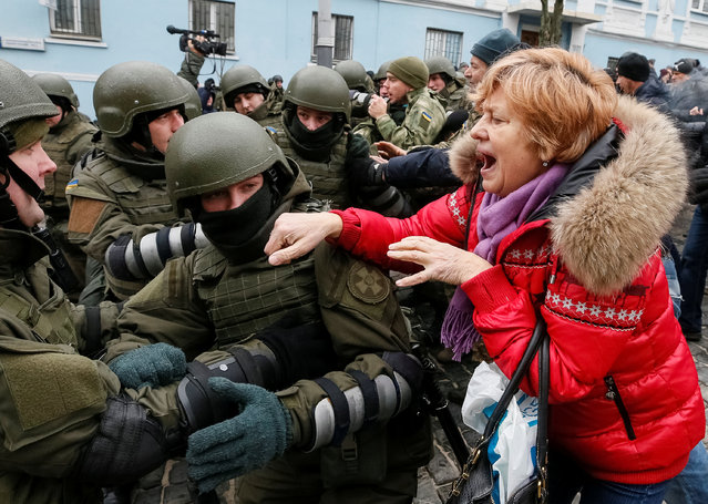 A supporter of former Georgian President Mikheil Saakashvili clashes with Ukrainian National Guard officers in Kiev, Ukraine, Tuesday, December 5, 2017. (Photo by Gleb Garanich/Reuters)