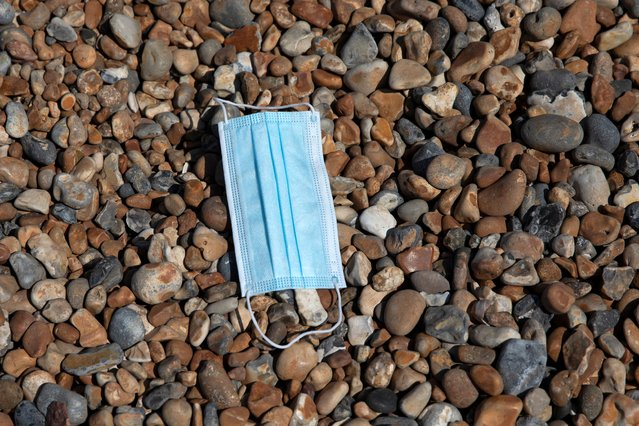 A face mask lies on Brighton Beach on July 31, 2020 in Brighton, England. High temperatures are forecast across the UK today, with some areas in the south expected to reach 33-34C. (Photo by Dan Kitwood/Getty Images)