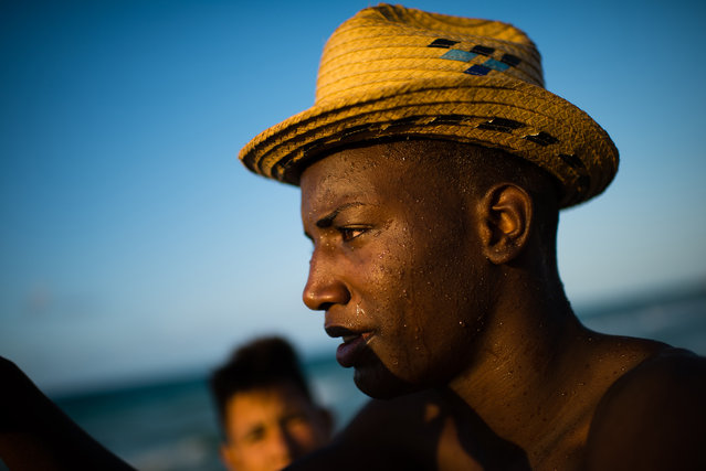 Yasiel Vazquez, 21, is pictured at Guanabo beach. The seaside beach town is about 20 miles East of Havana. The government has made the recovery of this beach a priority and some government and private homes are already being demolished. In some cases, new buildings will be built. (Photo by Sarah L. Voisin/The Washington Post)