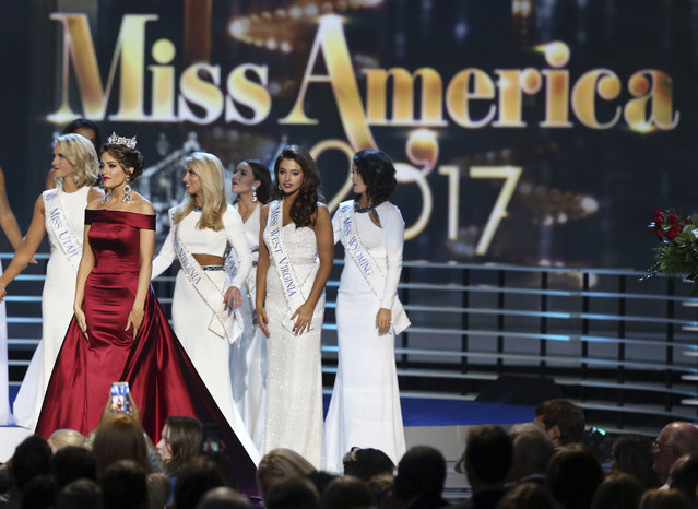 The outgoing Miss America, Betty Cantrell, second left, stands with contestants during the Miss America 2017 pageant, Sunday, September 11, 2016, in Atlantic City, N.J. (Photo by Mel Evans/AP Photo)