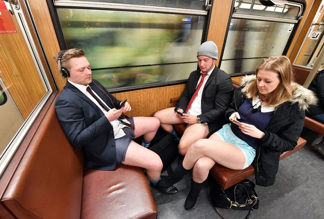 """A group of people wearing only underpants ride in the subway during the """"No Pants Subway Ride"""" in central Munich, Germany, 07 January 2018. (Photo by Joerg Koch/EPA/EFE/Rex Features/Shutterstock)"""