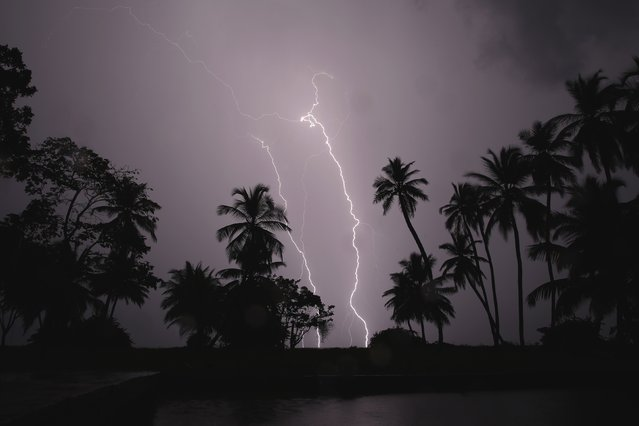 Lightning strikes over Lake Maracaibo in the village of Ologa, where the Catatumbo River feeds into the lake, in the western state of Zulia October 23, 2014. (Photo by Jorge Silva/Reuters)