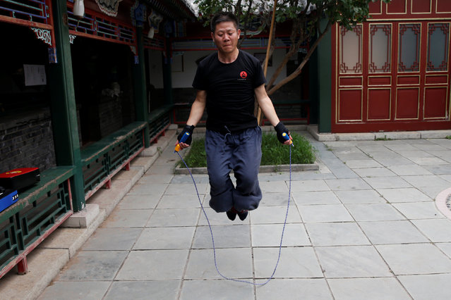 "Kung Fu master Xing Xi practices with skipping rope as he trains in mixed martial arts at his Kung Fu academy ""Kung Fu Zen"" in Beijing, China, July 3, 2016. (Photo by Kim Kyung-Hoon/Reuters)"