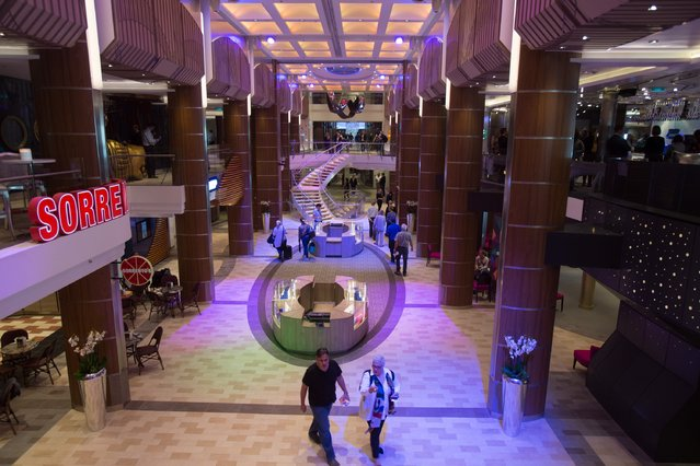 People walk around the restaurants onboard the cruise ship Quantum of the Seas which is currently docked at Southampton on October 31, 2014 in Southampton, England. (Photo by Matt Cardy/Getty Images)