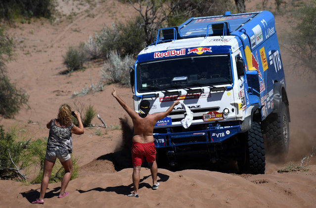 Kamaz Russian driver Eduard Nikolaev, co- driver Evgeny Yakovlev and mechanic Vladimir Rybakov compete during the 2018 Dakar Rally' s Stage 13 between San Juan and Cordoba in Argentina, on January 19, 2018. (Photo by Franck Fife/AFP Photo)
