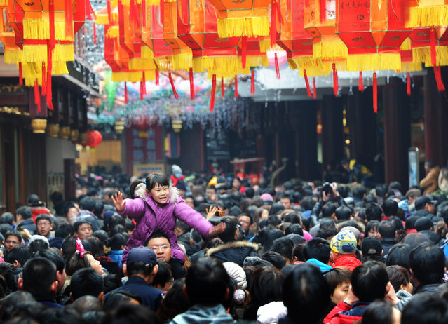 People visit a lantern show to celebrate Chinese Lunar New Year of Snake at Yuyuan Garden on February 11, 2013 in Shanghai, China. The Chinese Lunar New Year of Snake also known as the Spring Festival, which is based on the Lunisolar Chinese calendar, is celebrated from the first day of the first month of the lunar year and ends with Lantern Festival on the Fifteenth day. (Photo by VCG/VCG via Getty Images)