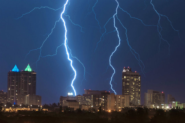 Lightning bolts over the historic Fountainbleu and Eden Roc hotels in Miami Beach, Florida on Saturday night, August 13, 2016. (Photo by Splash News and Pictures)