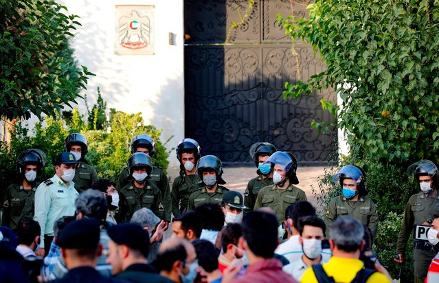 Security forces stand guard as Iranian students gather during a protest against a US-brokered deal between Israel and the UAE to normalise relations, in front of the UAE embassy in the capital Tehran, on August 15 2020. (Photo by AFP Photo/Stringer)