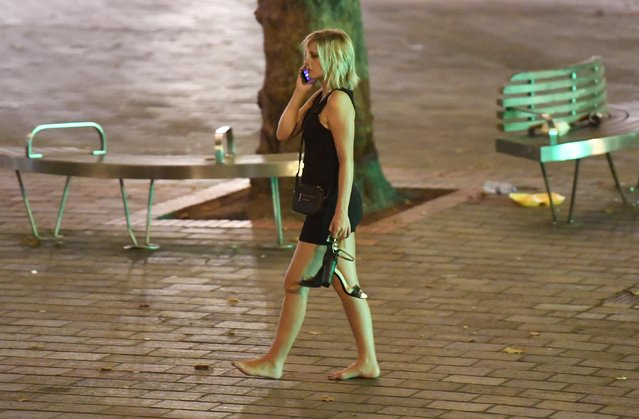 This fresher seems to have given up on wearing shoes for the night as she phones a friend after a night in Portsmouth, Hampshire on September 21, 2016. (Photo by Paul Jacobs/PictureExclusive.com)