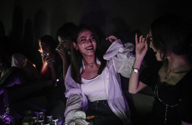 The women drink outside the disco bar on September 18, 2020 in Wuhan, Hubei province, China. As there have been no recorded cases of community transmission in Wuhan since May, life for residents is returning to normal. (Photo by Getty Images)