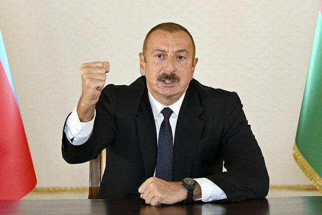 In this photo provided by the Azerbaijan's Presidential Press Office provided on Sunday, September 27, 2020, Azerbaijani President Ilham Aliyev gestures as he addresses the nation in Baku, Azerbaijan. Fighting between Armenia and Azerbaijan broke out Sunday around the separatist region of Nagorno-Karabakh and the Armenian Defense Ministry said two Azerbaijani helicopters were shot down. Ministry spokeswoman Shushan Stepanyan also said Armenian forces hit three Azerbaijani tanks. (Photo by Azerbaijani Presidential Press Office via AP Photo)
