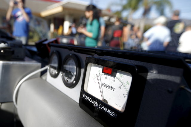 """The dashboard of a replica DeLorean car from the film """"Back to the Future Part II"""" is seen outside the Burger King featured in the movie, in Los Angeles, California, October 21, 2015. (Photo by Lucy Nicholson/Reuters)"""