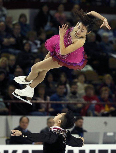 Sui Wenjing and Han Cong of China perform during the Pairs short program at the Skate America figure skating competition in Milwaukee, Wisconsin October 23, 2015. (Photo by Lucy Nicholson/Reuters)