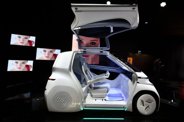 """Toyota """"I ride"""" concept car is seen at the Japanese carmaker's stand during the first press day of the Geneva International Motor Show on March 6, 2018 in Geneva. (Photo by Fabrice Coffrini/AFP Photo)"""
