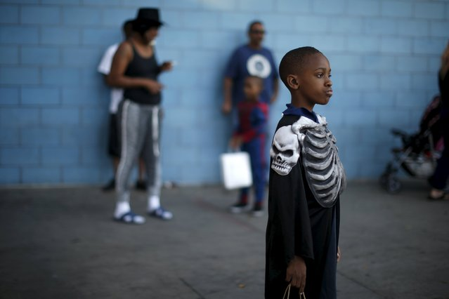 Children participate in the School on Wheels Skid Row Halloween Parade for children who live in shelters, motels, cars and on the street, in Los Angeles, California, United States, October 30, 2015. (Photo by Lucy Nicholson/Reuters)