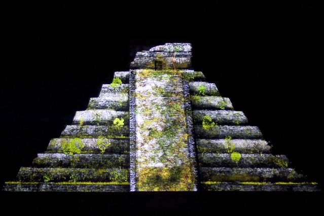 "A general view of the Kukulkan Pyramid during the ""Nights of Kukulkan"" sound and light show at the archaeological zone of Chichen Itza in Yucatan state December 10, 2014. (Photo by Lorenzo Hernandez/Reuters)"