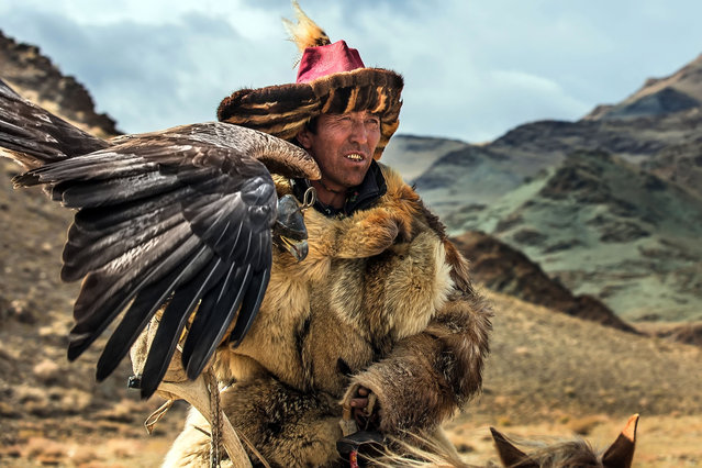 """""""The festival was founded in 1999 to preserve Kazakh's unique culture, tradition and to protect golden eagles"""". (Photo by Batzaya Choijiljav/Caters News)"""