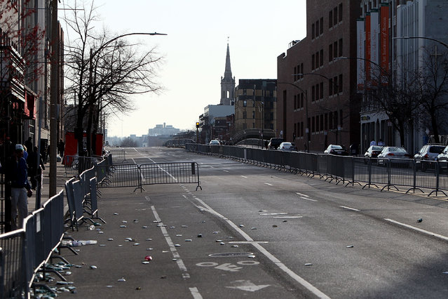 Beacon Street near Kenmore Square remains empty for the use of emergency vehicles after two explosive devices detonated at the finish line of the 117th Boston Marathon on April 15, 2013 in Boston, Massachusetts. (Photo by Alex Trautwig)