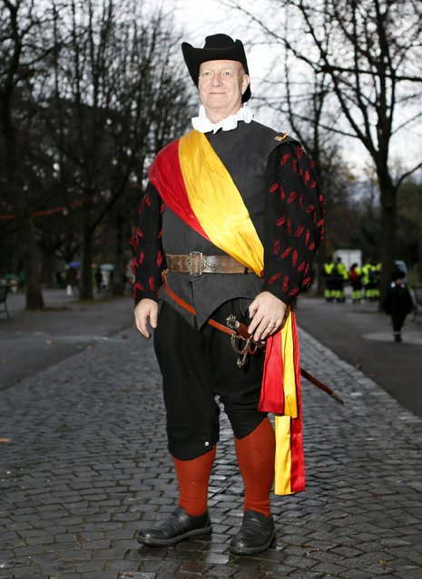 A member of Compagnie 1602 playing the role of an artilleryman poses before a procession in Geneva December 14, 2014. (Photo by Pierre Albouy/Reuters)
