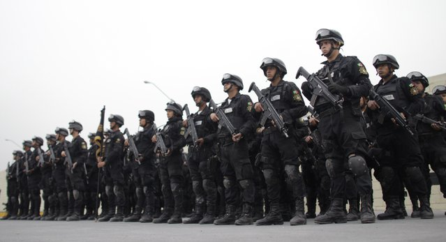 Members of the Fuerza Civil (Civil Force) police unit stand in formation during a media presentation to show the police model that the federal government wants for the rest of the country, at the police academy in Monterrey December 17, 2014. (Photo by Daniel Becerril/Reuters)