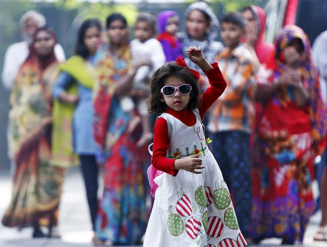 A girl dances as she takes part in celebrations after learning the initial results inside the residence of Janata Dal (United) leader Sharad Yadav in New Delhi, India, November 8, 2015. Prime Minister Narendra Modi was heading for a heavy defeat on Sunday in a key election in India's third most populous state Bihar, signalling the waning power of a leader who until recently had an unrivalled reputation as a vote winner. (Photo by Anindito Mukherjee/Reuters)