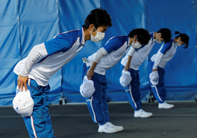 """Japanese moving company ART CORPORATION's employees wearing protective masks, following the coronavirus disease (COVID-19) outbreak, practice bowing to customers at the company's training facility """"ART moving training house"""" in Sagamihara, Kanagawa Prefecture, Japan on November 22, 2020. The training facility, which was build to raise the quality of customer service and train skills of employees, trains between 1,500 and 2,000 employees every year. (Photo by Kim Kyung-Hoon/Reuters)"""