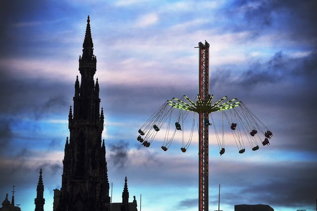 Members of the public enjoy a ride on the star flyer on December 18, 2014 in Edinburgh, Scotland. The star flyer is one of a number of rides situated in Princes Street Gardens in Edinburgh along with a ice rink carousel and Big Wheel, open from late November and running until January 4, 2015. (Photo by Jeff J. Mitchell/Getty Images)