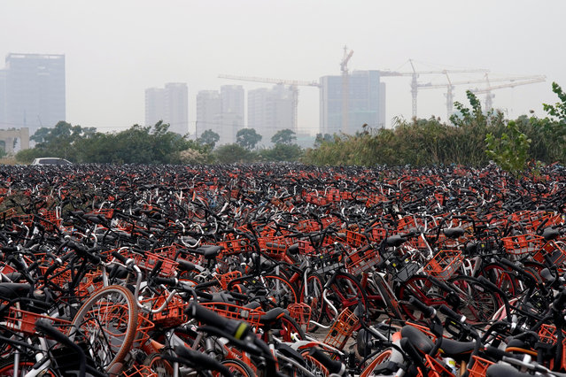 Bicycles of various bike-sharing services are seen at an urban village in smog during a polluted day in Shanghai, 2017. Rapid expansion of shared bicycle companies across China has led to massive piles of abandoned bikes as supply outstrips demand. (Photo by Aly Song/Reuters)