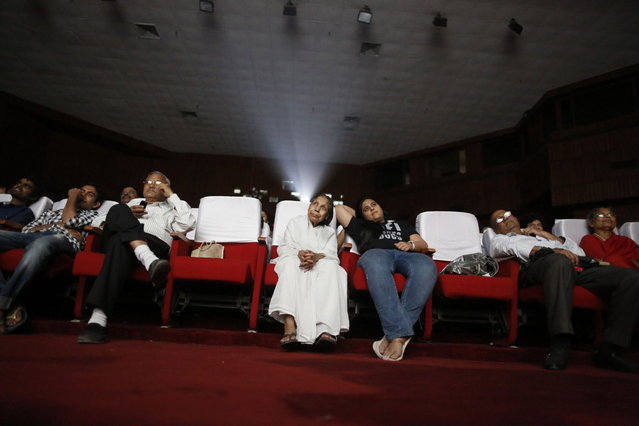 An audience watches a Hindi movie being screened during a festival celebrating 100 years of Indian cinema in New Delhi April 30, 2013. (Photo by Danish Siddiqui/Reuters)