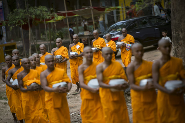 Bangladeshi Buddhists take lunch during the Buddha Purnima on April 29, 2018 in Cox's Bazar, Bangladesh. Buddha Purnima or Vesak marks the birth anniversary of Gautama Buddha, the founder of Buddhism, as followers commemorate the birth of Buddha, his attaining enlightenment and his passing away. (Photo by Allison Joyce/Getty Images)