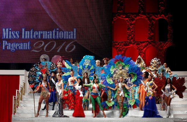 Contestants wearing national costumes pose in the opening of the 56th Miss International Beauty Pageant in Tokyo, Japan October 27, 2016. (Photo by Kim Kyung-Hoon/Reuters)
