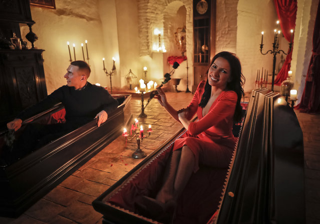 Events manager Tami Varma and her brother Robin, a PhD student, the grandchildren of Devendra Varma, a scholar of English gothic tales and an expert in vampire lore, pose in coffins at Bran Castle, in Bran, Romania, Monday, October 31, 2016. (Photo by Vadim Ghirda/AP Photo)